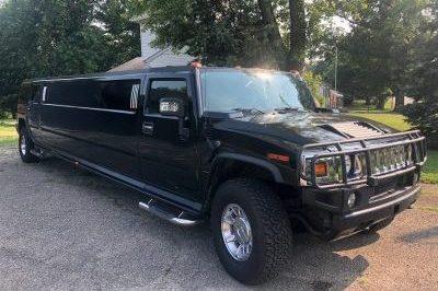 black hummer limo side profile