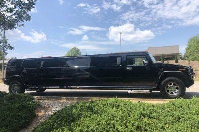 black h2 hummer limo outside